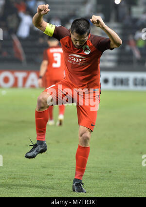 (180313) -- DOHA, March 13, 2018 (Xinhua) -- Al-Rayyan's Rodrigo Tabata celebrates during the AFC Champions League - Stock Photo