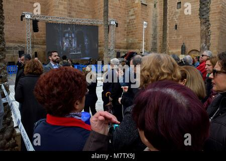 A crowd stands at the entrance of the Cathedral in Almeria, Spain, where the funeral of young Gabriel Cruz will - Stock Photo