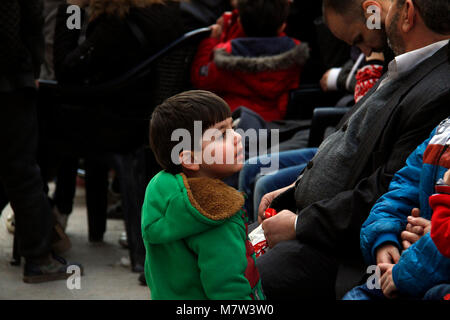 (180313) -- DAMASCUS, March 13, 2018 (Xinhua) -- An evacuated boy waits at a temporary shelter in Wafidin area, - Stock Photo
