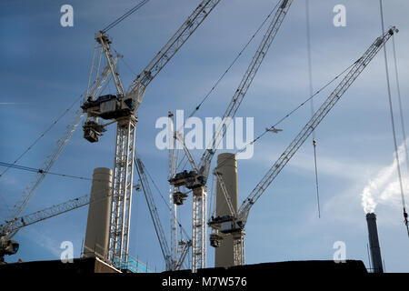 Battersea Power station - construction site, several cranes and original chimneys - Stock Photo