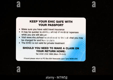 The back side of a european health insurance card (EHIC), issued by the National Health Service (NHS) in Britain. - Stock Photo
