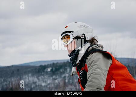 female ski patroller on mountain - Stock Photo