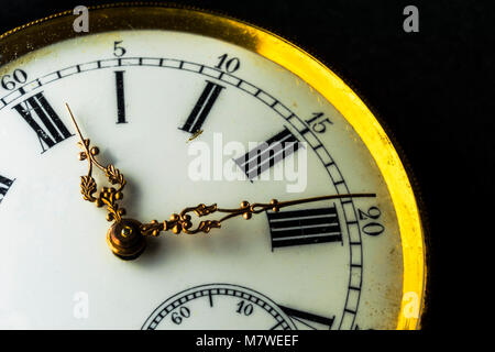 Close-up on a old watch with clipped black background - Stock Photo