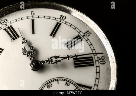Monochromatic close-up on a old watch with clipped black background - Stock Photo