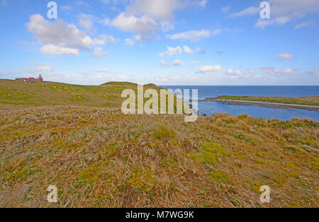 Lighthouse and Grassland at the end of the World on Cape Horn in Chile - Stock Photo