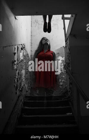 The suicide girl ghost in red dress show up after death - Stock Photo
