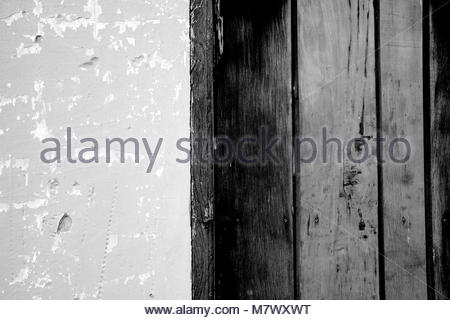 Old doors and wall textures close in black and white - Stock Photo