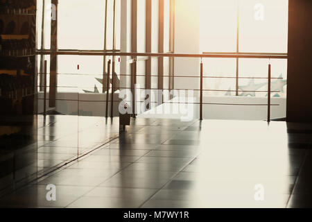 Hall in an office building with a glass wall, can be used background for your text - Stock Photo