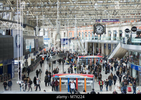 crowds of commuters at Waterloo station UK - Stock Photo