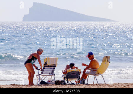 Old age pensioners with Benidorm Island / L'illa de Benidorm / La isla de Benidorm in the background, Benidorm, - Stock Photo