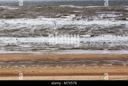 NETHERLANDS, APRIL 2017: The Windy Cold Sand Beach on the North of the Europe. There is a Small Figure of Kitersurfer - Stock Photo