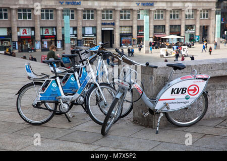 Germany, Cologne, rental bikes of the competing providers German Railway (Ford-Pass-Bike, DB Call a Bike) and Koelner - Stock Photo