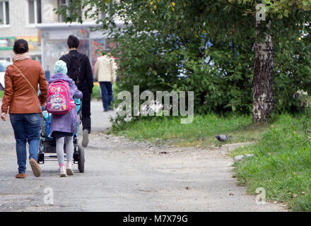 Come back home from school. Family enjoy after kids coming back. - Stock Photo
