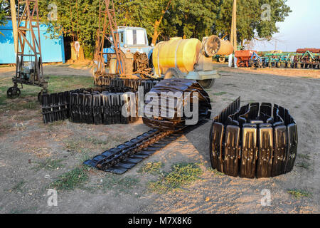 Track new Combine. Parts of agricultural machinery. Track prepared for mounting on the harvester. - Stock Photo