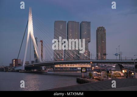 Erasmusbrug (Erasmus Bridge) and De Rotterdam buildings city skyline at twilight, Rotterdam, The Netherlands.