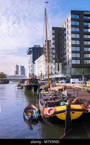 Leuvehaven harbour, where boat exhibits from the Maritime Museum and modern Dutch architecture can be seen together, - Stock Photo