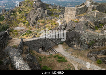 Beautiful historic castle in Monsanto Portugal in the afternoon on a cloudy day - Stock Photo