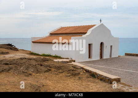 Beautiful Greek orthodox church on sea coast in Agios Nikolaos, Zakynthos, Greece - Stock Photo