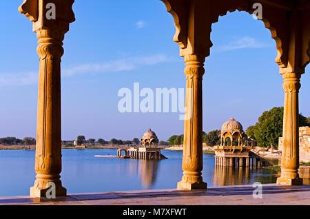 Gadi Sagar Temple in Gadisar lake, Jaisalmer, Rajasthan India - Stock Photo