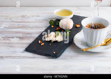 cheese with white mold, mint, honey, walnuts, coffee with milk, breakfast, top view, copy Space - Stock Photo