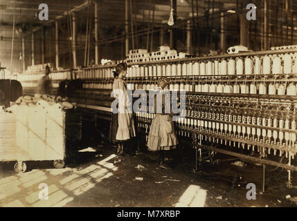 Two Young Spinners, Full-Length Portrait in Spinning Room at Cotton Mill, Newberry, South Carolina, USA, Lewis Hine - Stock Photo
