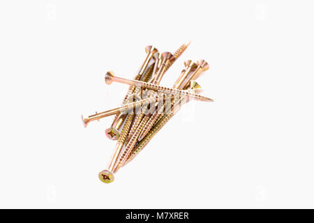 Bunch of yellow zinc coated philips screws on white background - Stock Photo