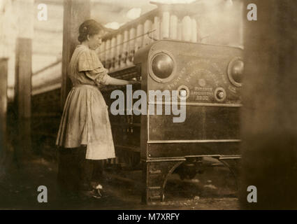 Young Girl Working in Yarn Mill, Full-Length Portrait, Anniston, Alabama, USA, Lewis Hine for National Child Labor - Stock Photo