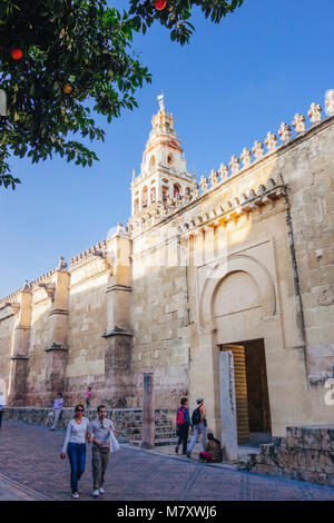 Cordoba, Andalusia, Spain : Mosque–Cathedral of Cordoba. Tourists walk past the Puerta de los Deanes gate and bell - Stock Photo