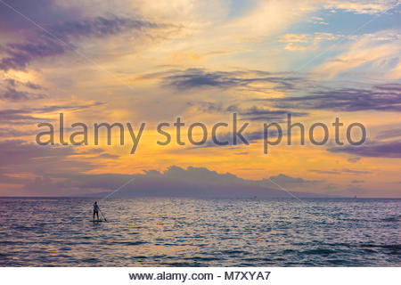 Paddleboarding and tropical sunset from Kamaole Beach Park 3 Pacific Ocean on the island of Maui in the state of - Stock Photo