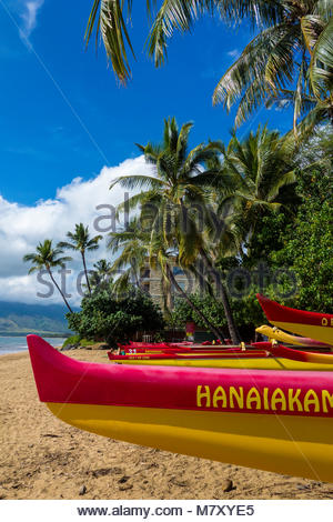Outrigger canoes on Sugar Beach at the Kihei Canoe Club in Kihei on the island of Maui in the State of Hawaii USA - Stock Photo