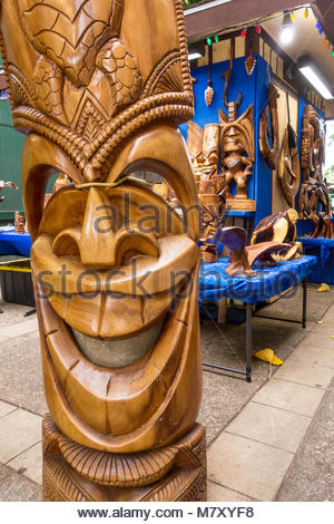 Smiling Tiki Hawaiian culture statues for sale in Lahaina on the island of Maui in the State of Hawaii USA - Stock Photo