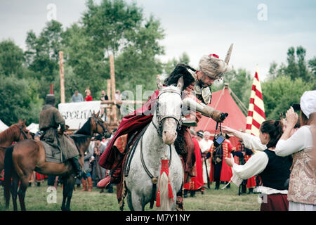 Armored Nobleman on horseback at the Battle of Klushino 1610 reenactment - July 04, 2010 in Warsaw, Poland - Stock Photo
