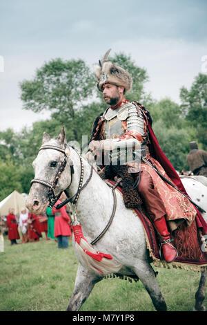 Polish Nobleman on horseback  at the Battle of Klushino 1610  reenactment - July 04, 2010 in Warsaw, Poland - Stock Photo