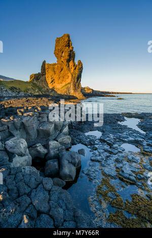 Londrangar Sea Stacks-basalt volcanic dikes, in the distance, Snaefellsjokull Glacier, Snaefellsnes Peninsula, Western - Stock Photo