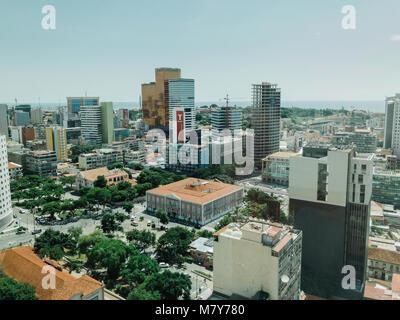 LUANDA, ANGOLA - MARCH 11, 2018: Construction continues in the Angolan capital of Luanda despite ongoing economic - Stock Photo
