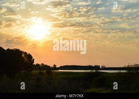 Morning sun over a lake in Spain. - Stock Photo