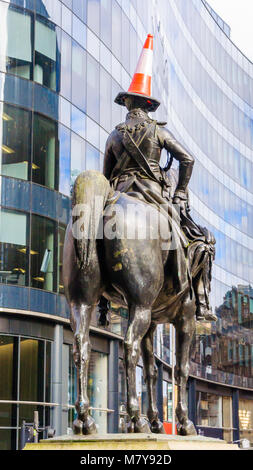 Duke of Wellington statue with a traffic cone on his head astride a horse  in front of GOMA, Royal Exchange Square, - Stock Photo