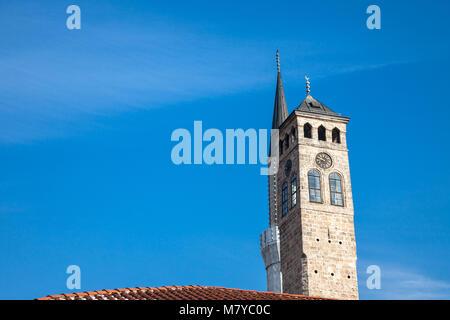 Minaret of the Gazi Husrev begova Mosque next to the clocktower of Sarajevo bazaar, in Bosnia and Herzegovina   - Stock Photo