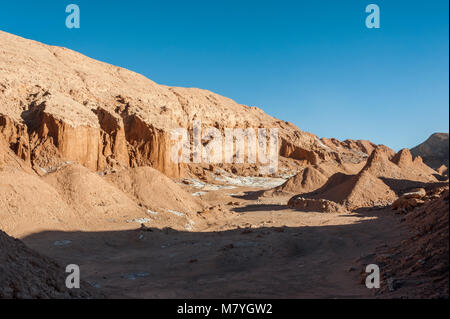View of the Cordillera de la Sal, white Salt emerging from the Rocks, Saline Mountains in the Atacama Desert, Andes - Stock Photo