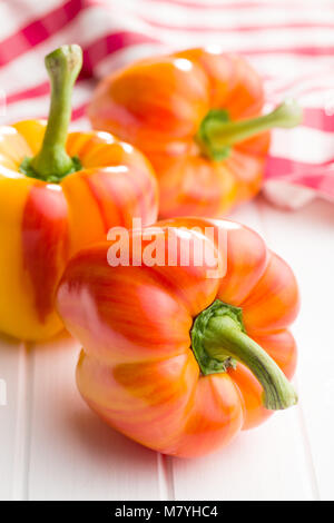 Double color bell pepper on white table. - Stock Photo