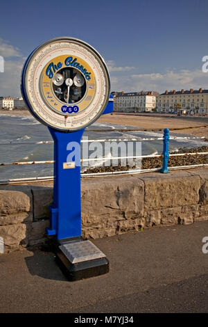 Old fashioned weighing scales on Llandudno pier, North Wales coast - Stock Photo