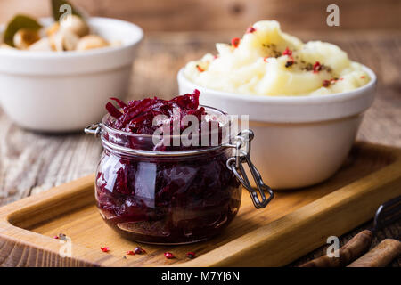 Healthy vegetarian meal. Mashed potatoes and homemade pickled mushrooms and beetroot salad on rustic wooden table - Stock Photo