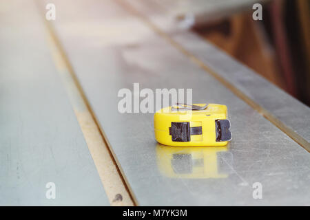 Yellow Tape Measurer on Sawing Machine. Close up. Copyspace. - Stock Photo