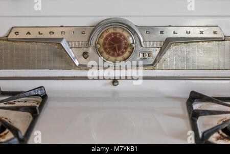 A detail image of an vintage Caloric Deluxe Stove in an abandoned house in southampton, ny. - Stock Photo
