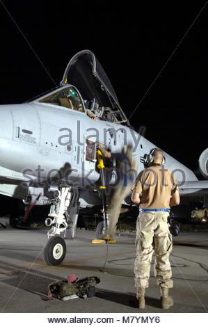 Fairchild Republic A-10 Thunderbolt II. Two crew chiefs assist an A-10 Thunderbolt II pilot at Bagram Air Base, - Stock Photo