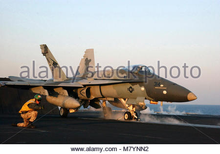 McDonnell Douglas FA-18C Hornet. Sea of Japan (Mar. 18, 2003) -- A 'Shooter' gives the signal to launch an F/A-18C - Stock Photo