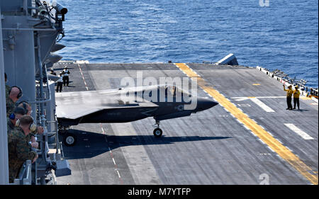 180312-N-RI884-0281  EAST CHINA SEA (March 12, 2018) Marine Corps Lt. Gen. Lawrence Nicholson, commanding general of III Marine Expeditionary Force, and staff observe flight operations of the F-35B Lightning II aboard the amphibious assault ship USS Wasp (LHD 1) in the Indo-Pacific region. The visitors observed flight operations by F-35B Lightning II assigned to the 'Green Knights' of Marine Fighter Attack Squadron (VMFA) 121. The Wasp Expeditionary Strike Group (ESG) is conducting a regional patrol designed to strengthen regional alliances, provide rapid-response capability and advance the up Stock Photo