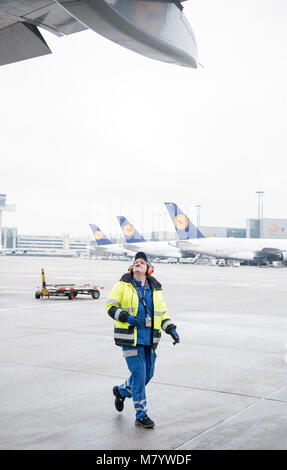 08 March 2018, Germany, Frankfurt: Sabrina Boock, in charge of ground handling operations,  inspects the wings of - Stock Photo