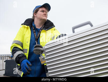 08 March 2018, Germany, Frankfurt: Sabrina Boock, in charge of ground handling operations, loads a suitcase into - Stock Photo
