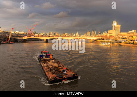 River Thames, London, 13th March 2018. Sunshine on a rainy day - view across the River Thames on the South Bank. - Stock Photo